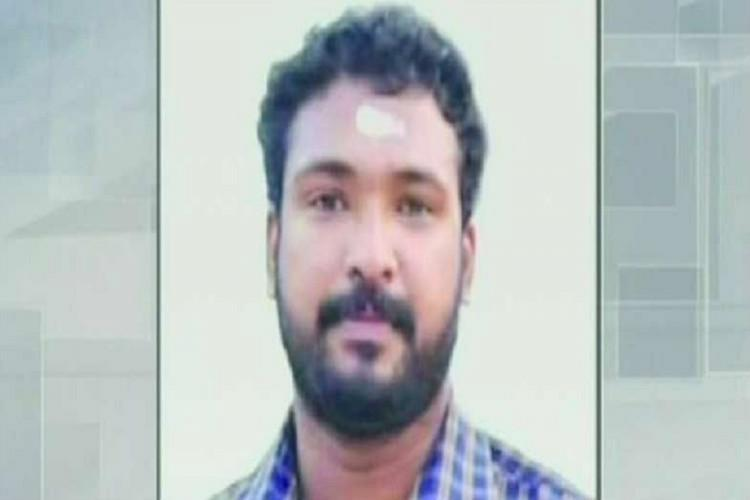 Kerala murder accused Midhun on a white background