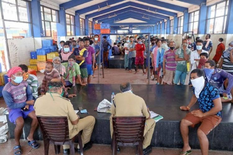 Migrant labourers given ID card in Kozhikode Kerala after lockdown