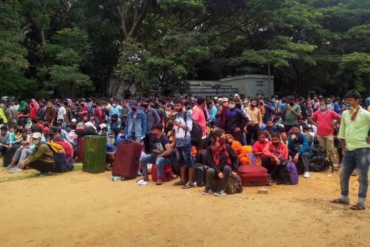 Migrant workers gather at Bangalore Palace Grounds