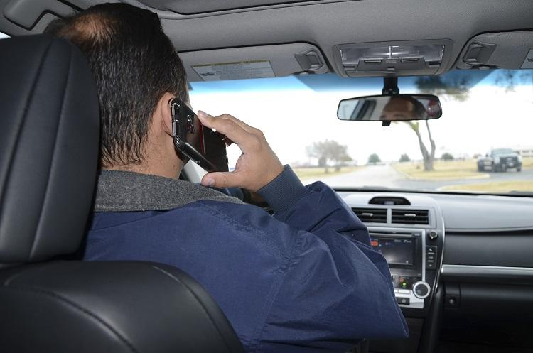 Cant book drivers for talking on mobile while driving Kerala HC to police