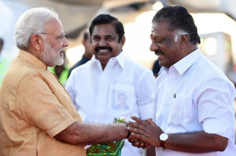 OPS greeting Modi with EPS