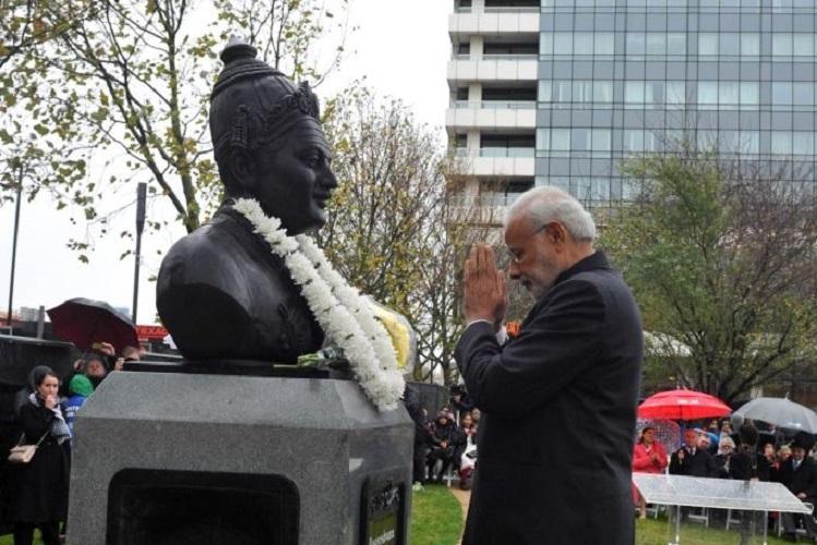 Modi takes Lingayat issue to London garlands Basaveshwara statue on UK tour