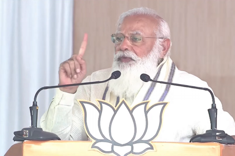 Prime Minister Modi at an election rally wearing white