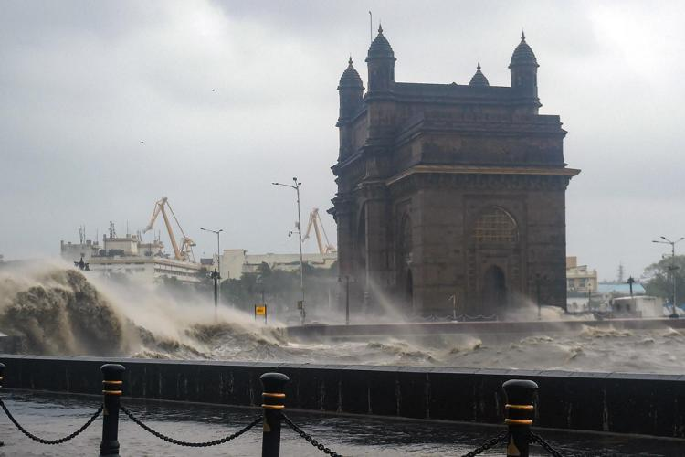 India Gate in the background as waves crash due to cyclone Tauktae