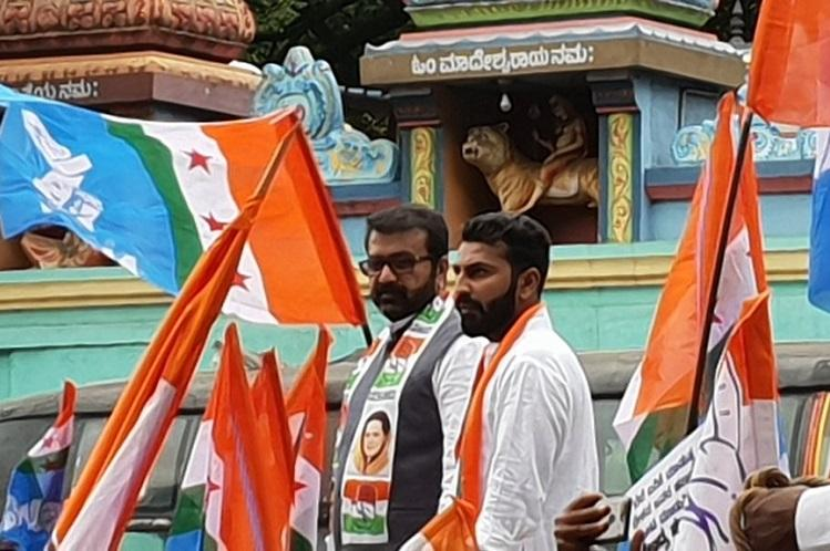 Not sacked Months after brutal assault Nalapad Haris spotted at Congress protest