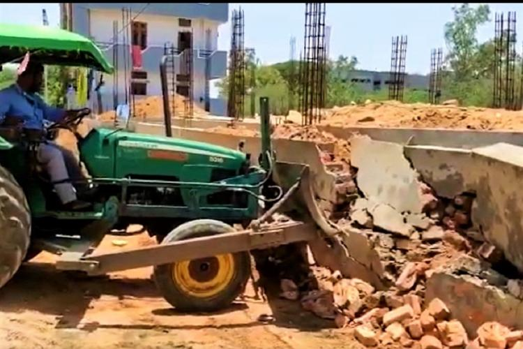 The under-construction home of a journalist demolished for not having a building permit in Telangana