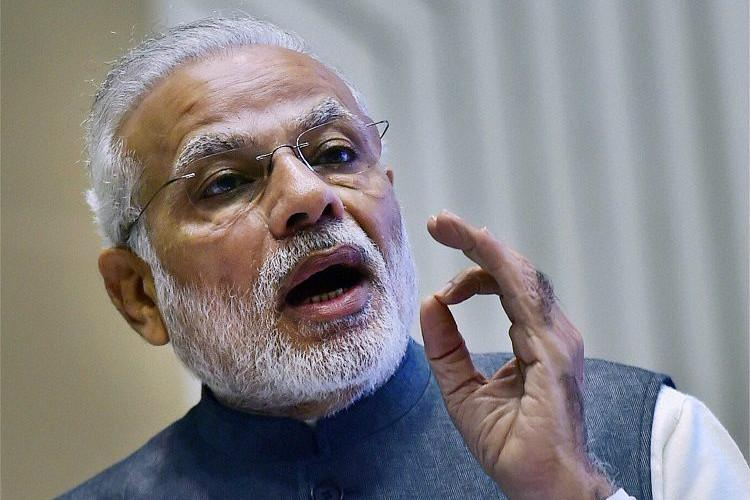 Demonetisation broke backs of terror human trafficking PM Modi