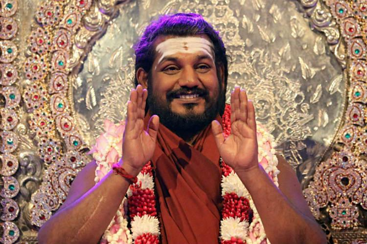 Cant arrest Nithyananda till HC completes hearing his plea Police tell trial court