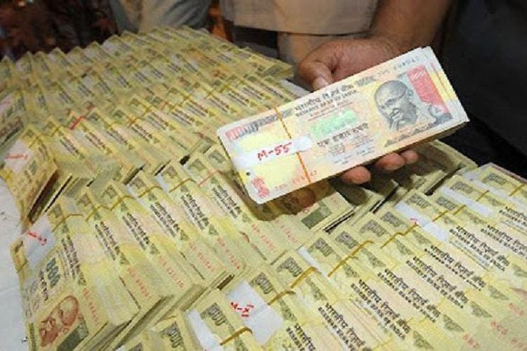Four held with banned notes of Rs 398 crore in Bengaluru