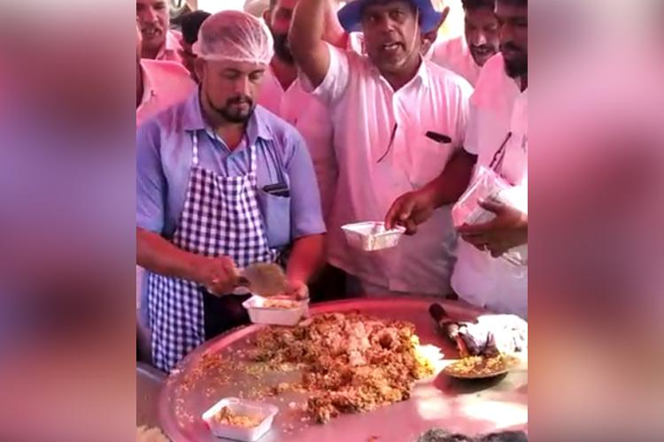 Protesting price hike Kerala workers cook and distribute onion-less biriyani