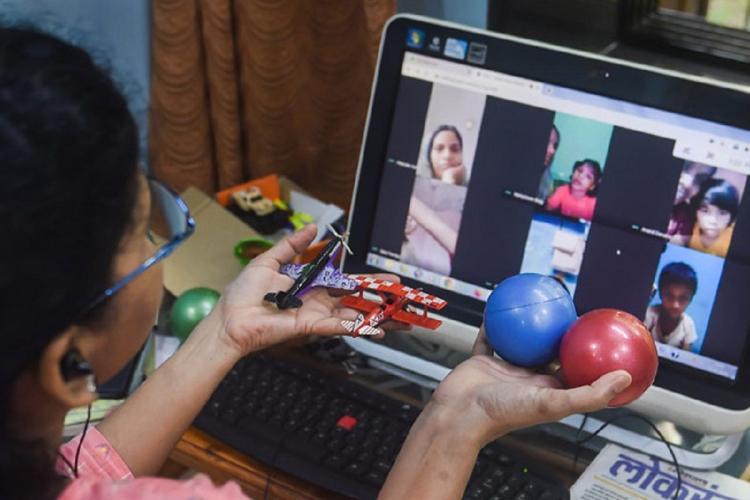 A girl student attending online class on a laptop