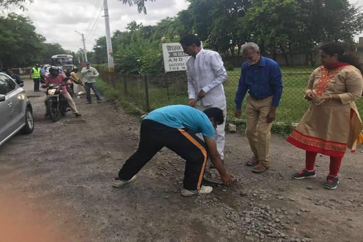 Frustrated with official apathy Secunderabad senior citizens fill potholes on their own