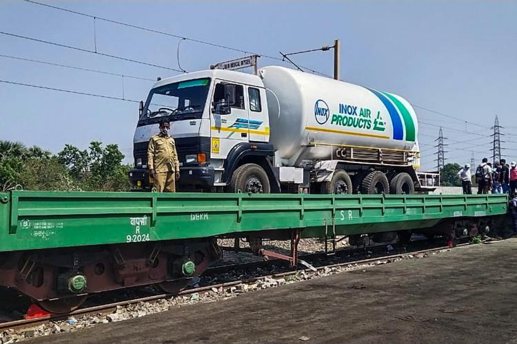 Liquid Medical Oxygen tanker on a placed on a flat wagon being transported through Railway