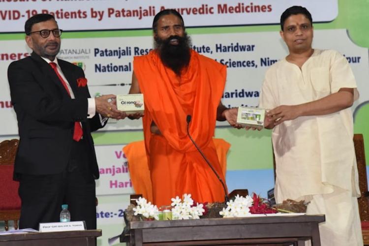 Baba Ramdev and Acharya Balakrishna at the launch of Coronil by Patanjali