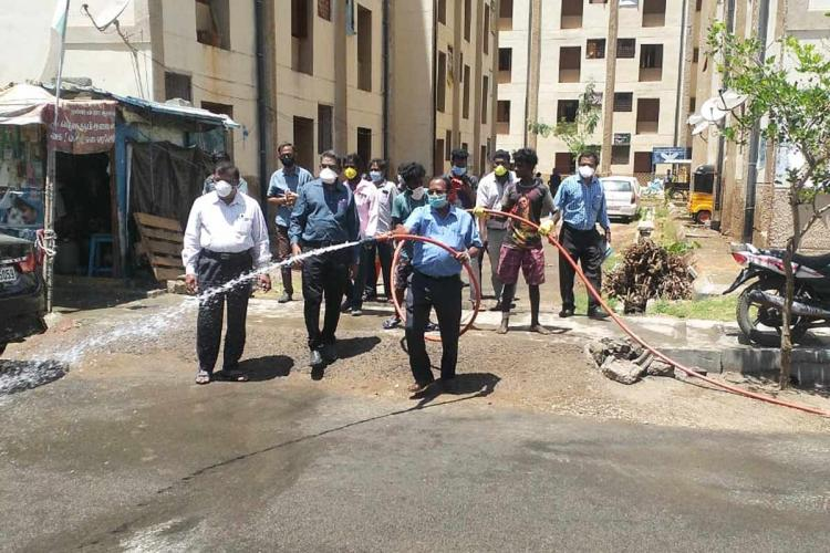 Disinfectant being sprayed at Perumbakkam tenement by officials