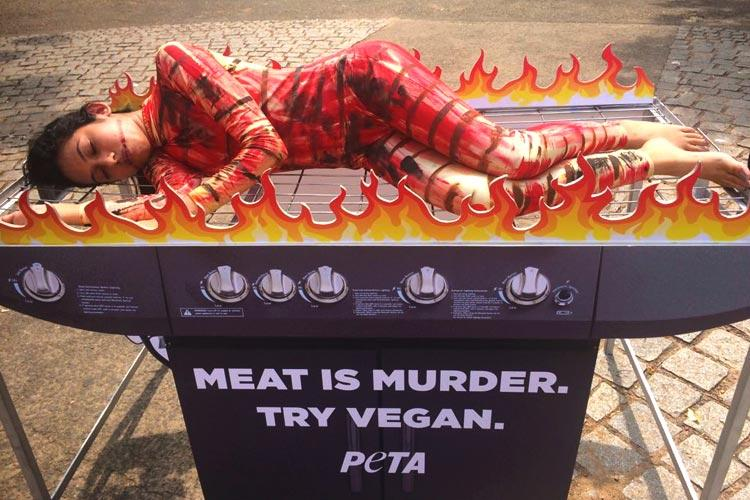 PETA puts up human barbecue in Kerala says meat is murder try vegan