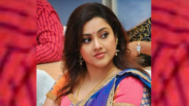 South Indian actor Meena posing for a picture