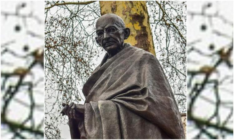 Sculpture of Mahatma Gandhi standing is seen