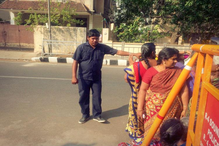 After criticism police cover at Poes Garden scaled down private guards in