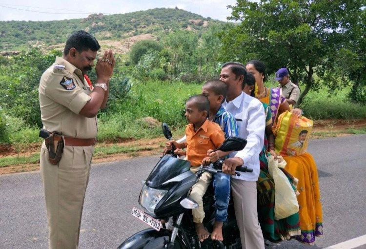 The story behind the viral photo of an Andhra cop folding hands before a family