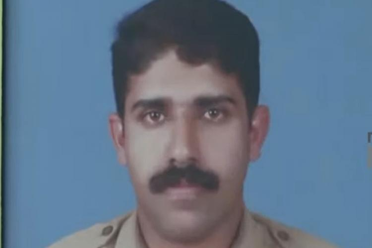 A passport photo of police constable Ajesh Paul