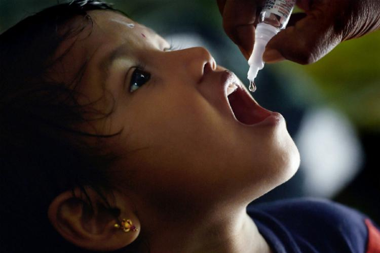 A Child Receiving Polio drop
