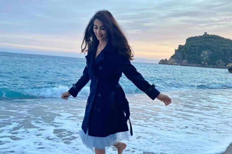 Pooja Hegde walking along the Malpossa beach in Italy