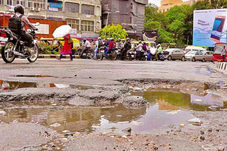 Karnataka CM wants BBMP to fix Bengalurus 15935 potholes in 10 days LOL