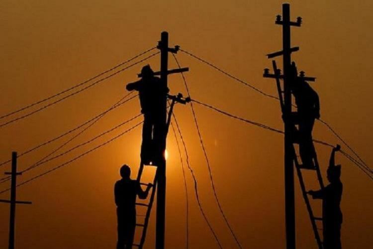 Men doing repair work on the electricity supply towers