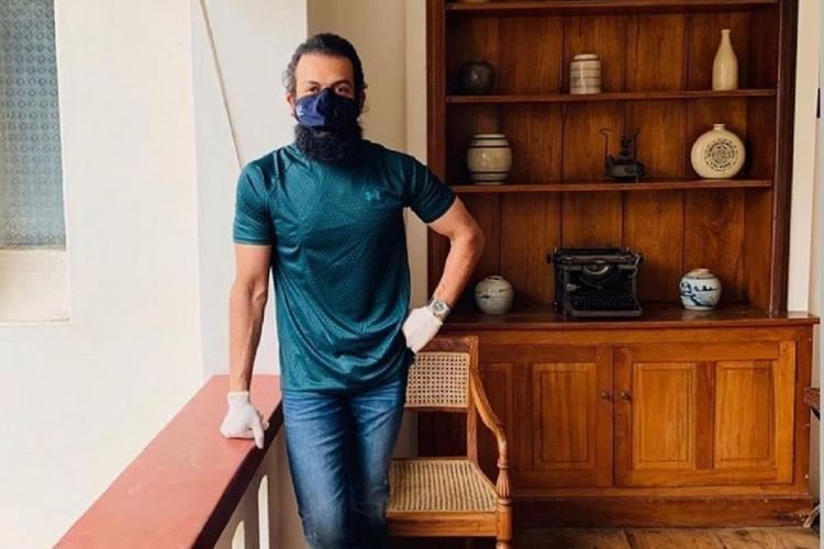 Prithviraj Sukumaran wearing a mask at a cafe