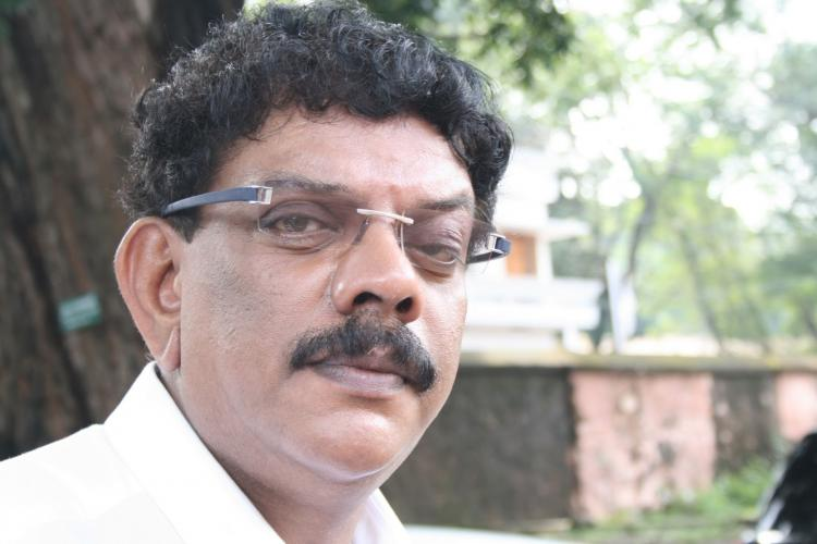 No Priyadarshan was not struggling to get a bottle of water in Chennai floods