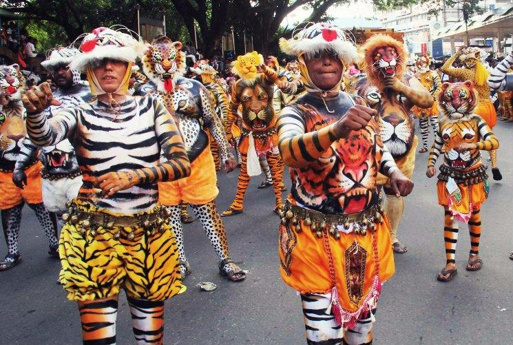 Tigresses roar Keralas Pulikali dance sees women actors for the first time in 200 years