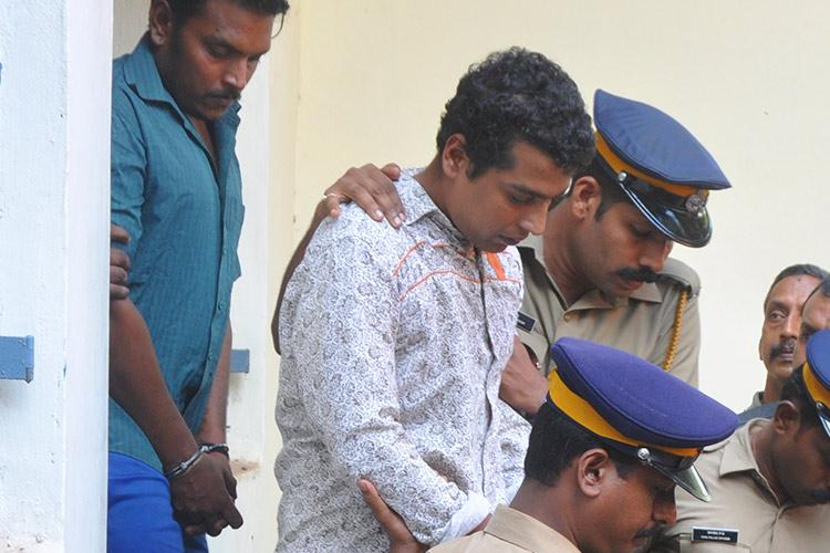 Malayalam actor assault Kerala cop arrested suspended for helping Pulsar Suni contact Dileep