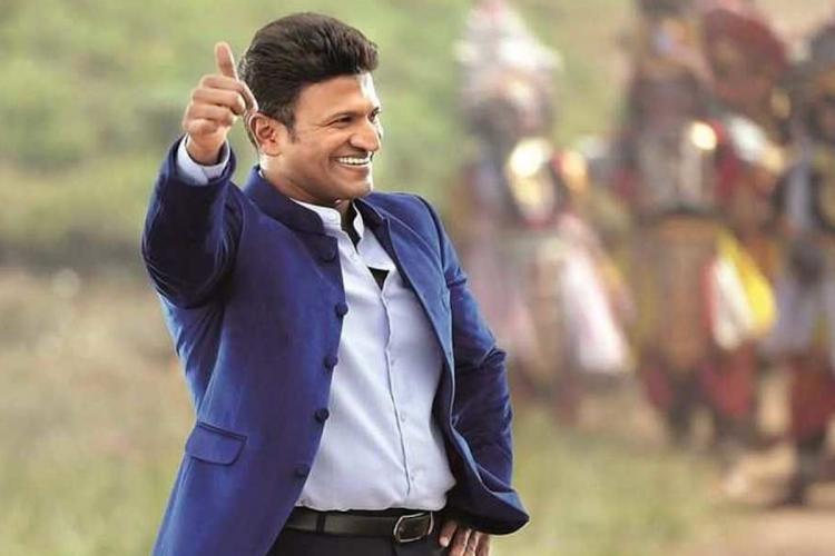 Puneeth Rajkumar showing thumbs up