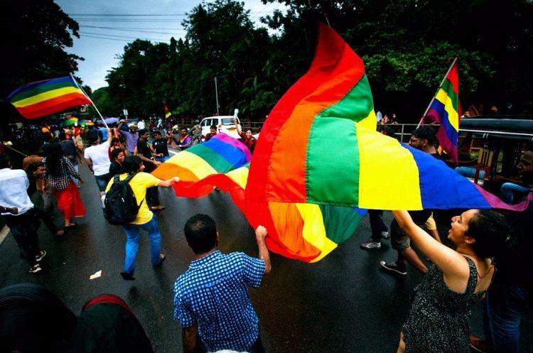 LGBTQIA People on road participating in a queer pride march