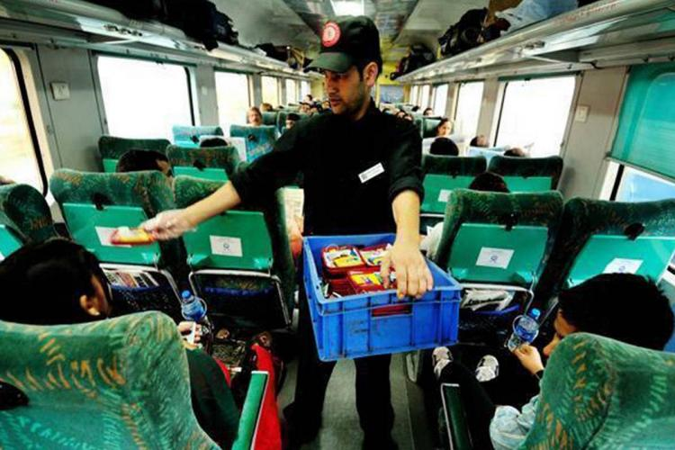 IRCTC employee serving food on Shatabdi train