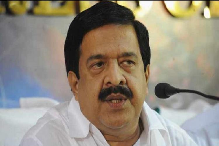 Ramesh Chennithala speaking into a mic