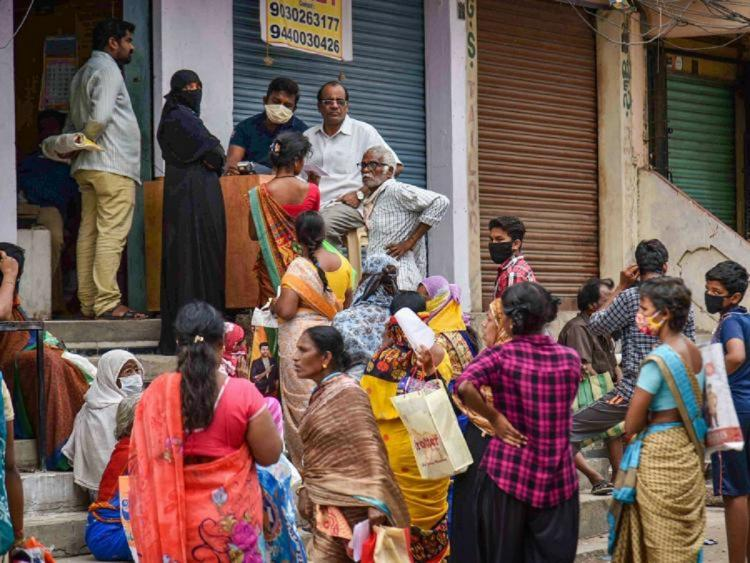 People standing in a jumbled queue at a ration store waiting for the ration