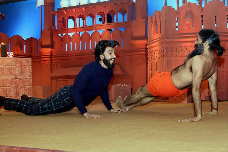 Watch Baba Ramdev Vs Ranveer Singh the most twisted dance contest youll ever see