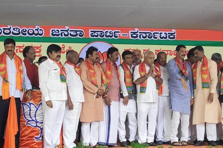 16 of 17 disqualified Karnataka MLAs join BJP Congs Roshan Baig missing