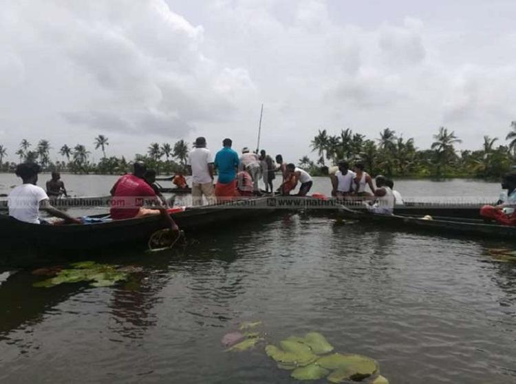TV news crews boat capsizes during Kerala flood coverage One dead one missing