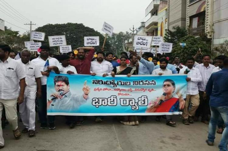 Protestors led by Roja don flowers on their ears in agitation against AP CM