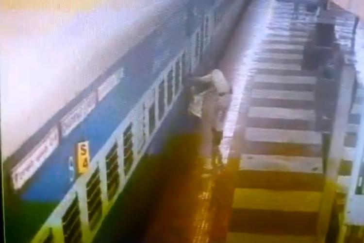 Watch Dramatic rescue by railway cop who saves man from going under train in Hyderabad