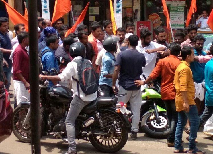 RSS workers rough up press photographer in Malappuram