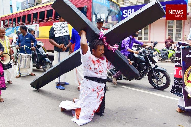 Pleading for justice for his dead daughter father drags cross in Keralas capital city