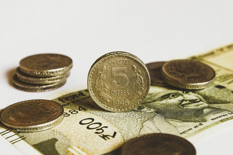Rupee feels slowdown pain slips to over 72 against US dollar