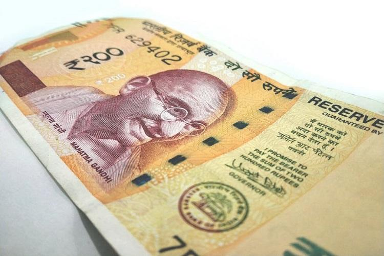 Sustained rupee falling credit-negative for Indian firms Moodys