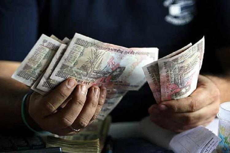 Rupee up 14 paise to 68.44 against USD