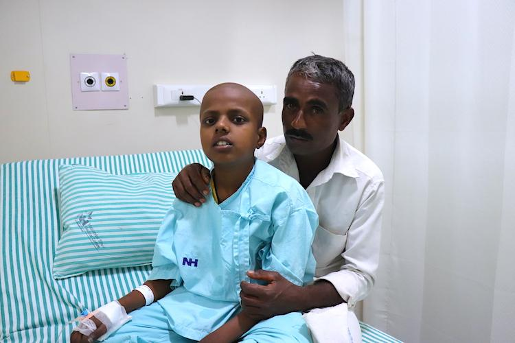 This farmer may lose his son to cancer without urgent treatment your donation will help them