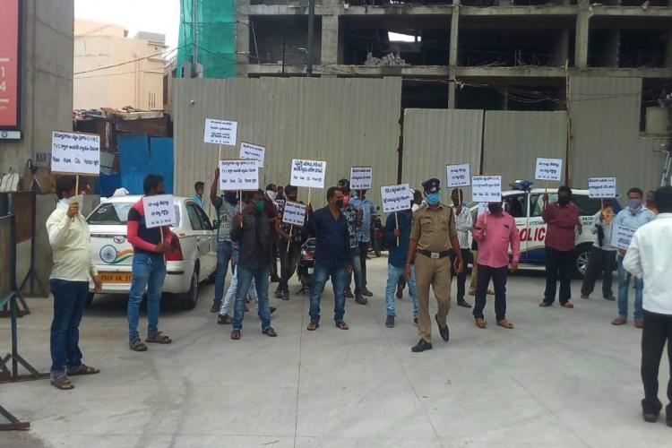 Street hwakers of Sultan Bazar staging a protest holding placards